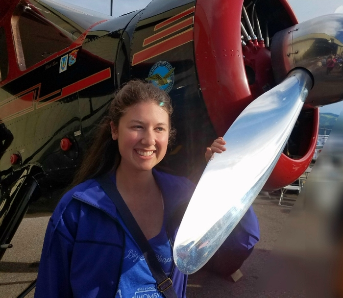 Lacey Marie posing with plane